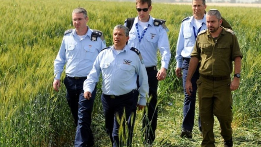 Click photo to download. Caption: Israel Air Force Commander Major General Amir Eshel (front) investigating the accident in which two Air Force pilots were killed in an Israeli military helicopter crash in the Revadim area south of Gedera on Tuesday, March 12. Credit: Yossi Zeliger/Flash90
