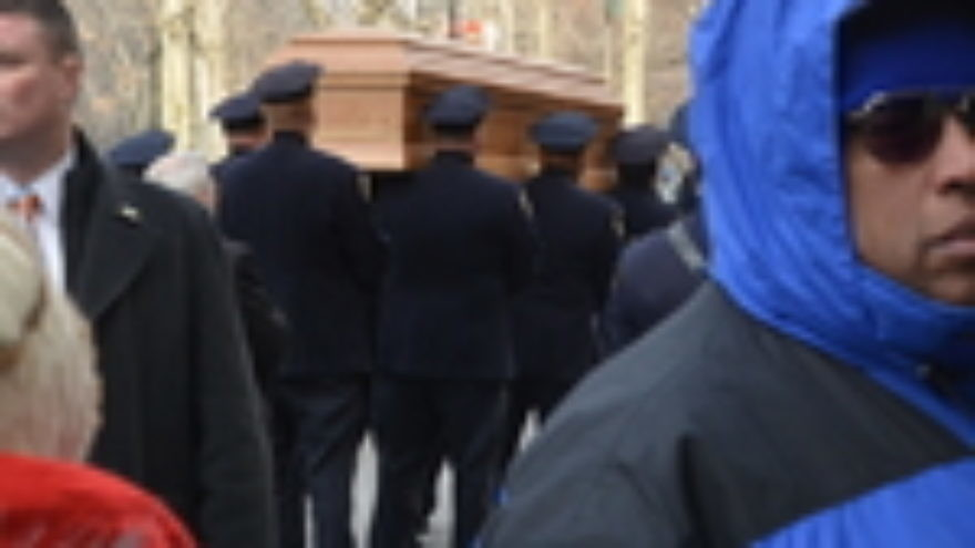 Click photo to download. Caption: On Monday, the casket of the late New York mayor Ed Koch is placed in the hearse that would carry his body to Trinity Cemetery in upper Manhattan for his Jewish burial. Credit: Maxine Dovere.