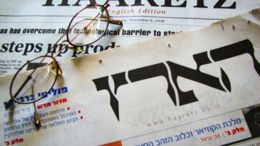 "English and Hebrew editions of the Israeli newspaper ""Haaretz."" Credit: Wikimedia Commons."