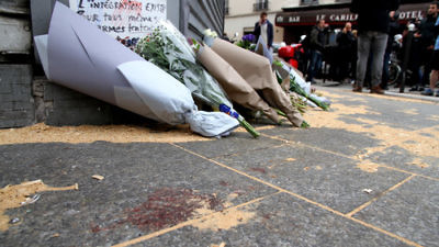 The Le Petit Cambodge restaurant—site of one of six coordinated Islamist terror attacks in Paris on Friday—with a makeshift memorial of flowers and blood staining the ground on the day after the attacks. Credit: Maya-Anaïs Yataghène via Wikimedia Commons.