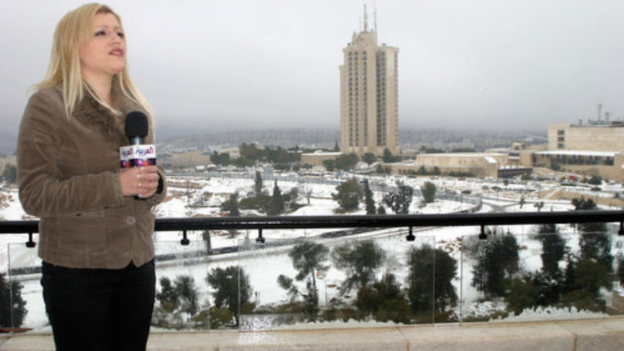 Rima Mustafa, a reporter for the Saudi-owned Arabic-language television news channel Al Arabiya, in Jerusalem. Credit: Oren Rosenfeld via Wikimedia Commons.