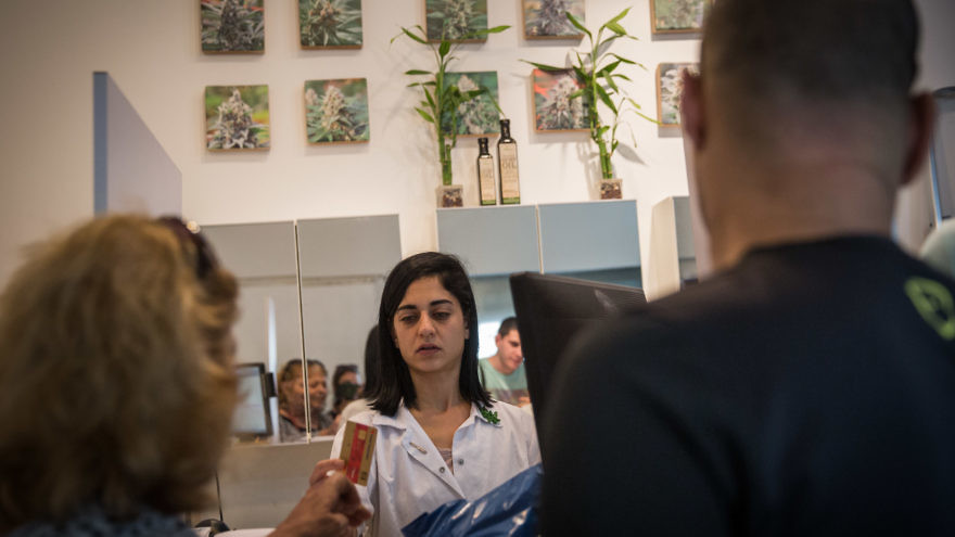"""Pharmicists supply patients with prescribed medical marijuana at the """"Tikun Olam"""" store in Tel Aviv, on April 10, 2016. Tikun Olam Ltd. is the first, largest and foremost supplier of medical cannabis in Israel, and is one of leading medical cannabis companies in the world. April 10, 2016. Photo by Hadas Parush/Flash90."""