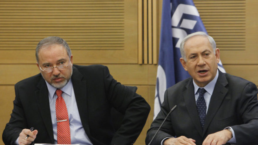 Israeli Prime Minister Benjamin Netanyahu (right) and then Foreign Minister Avigdor Lieberman at a meeting of the Likud-Beiteinu faction in the Knesset on March 11, 2014.