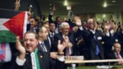 Click photo to download. Caption: Members of the Palestinian delegation at the United Nations General Assembly celebrate Nov. 29 upon the vote to upgrade Palestinian status to a non-member observer state Nov. 29. Credit: UN Photo/Rick Bajornas.