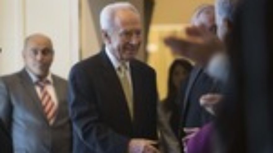 Click photo to download. Caption: Israeli President Shimon Peres greets representatives of the Israeli Christian communities at a ceremony held at the President's house in Jerusalem in honor of the leaders of the different Christian communities in Israel on Dec. 31, 2012. Credit: Yonatan Sindel/Flash90.
