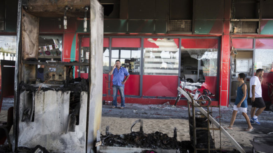 Click photo to download. The scene of a gas station in Ashdod that was hit directly by rocket fire from Gaza on the fourth day of Operation Protective Edge, July 11, 2014. Credit: Hadas Parush/Flash90.