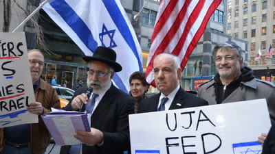"""Click photo to download. Caption: The April 8 rally in New York City against what protesters call the inclusion of """"pro-BDS groups"""" in the annual Celebrate Israel Parade. Holding the microphone is Israeli Member of Knesset Nissim Ze'ev (Shas), a surprise speaker at the rally. Credit: Maxine Dovere."""