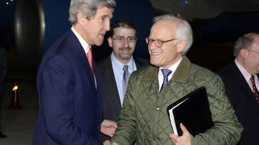 U.S. Secretary of State John Kerry (left) shakes hands with U.S. Special Envoy for Israeli-Palestinian Negotiations Martin Indyk at Ben Gurion International Airport while returning from a day trip to Jordan and Saudi Arabia on January 5, 2014. After the failure of Israeli-Palestinian peace talks, Indyk returned to his role at the Brookings Institution think tank, which was recently revealed to be funded by the Hamas-backing nation of Qatar. Credit: Matty Stern/U.S. Embassy Tel Aviv/Flash90.