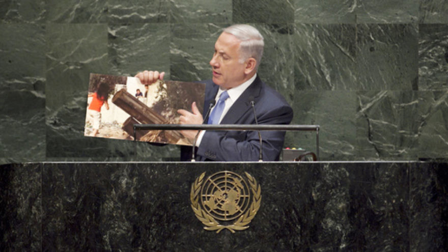 Click photo to download. Caption: Israeli Prime Minister Benjamin Netanyahu, addressing the United Nations General Assembly in New York City on Sept. 29, points to a picture of a Palestinian rocket launcher stationed in a civilian area of Hamas-controlled Gaza. Credit: UN Photo/Amanda Voisard.