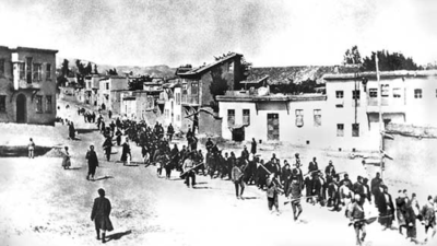 Armenians are marched to a nearby prison in Mezireh by armed Turkish soldiers in Kharpert, Armenia, in April 1915. Credit: Project SAVE via Wikimedia Commons.