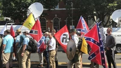 White-supremacist protesters carry Nazi and Confederate flags in Charlottesville, Va., on Aug. 12, 2017. Credit: Anthony Crider via Wikimedia Commons.