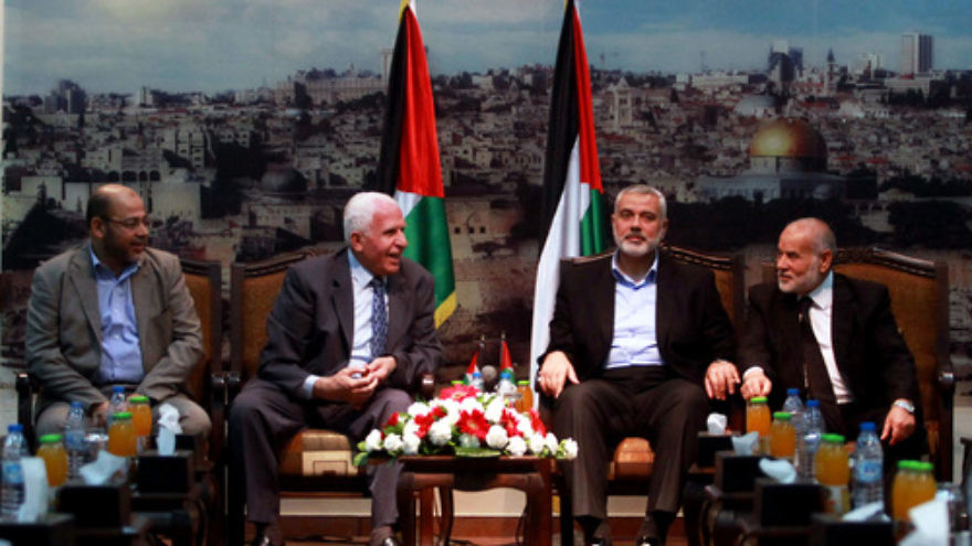 From left to right, senior Hamas leader Moussa Abu Marzouk, senior Fatah official Azzam Al-Ahmed, head of the Hamas government Ismail Haniyeh, and deputy speaker of the Gaza-based Palestinian Parliament Ahmed Bahar attend a meting in Gaza City on April 22, 2014. Hamas and Fatah signed a deal to establish a unity government this spring, but since then little progress has been made as the Palestinian factions continue to feel deep mistrust toward one another. Credit: Abed Rahim Khatib/Flash90.