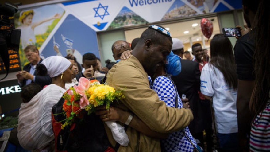 Ethiopian Jews are greeted by family members as they arrive at Israel's Ben-Gurion Airport, as part of an aliyah flight arranged by the Jewish Agency for Israel and sponsored by the International Christian Embassy Jerusalem in June 2017. Credit: Miriam Alster/Flash90.