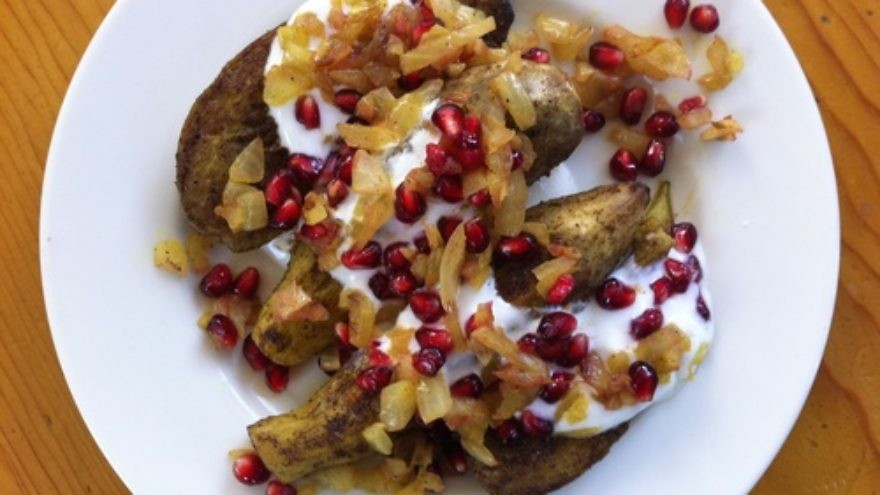 Click photo to download. Caption: Curried eggplant slap-down with yogurt, onion relish, and pomegranate, by chef Mollie Katzen. Credit: Mollie Katzen
