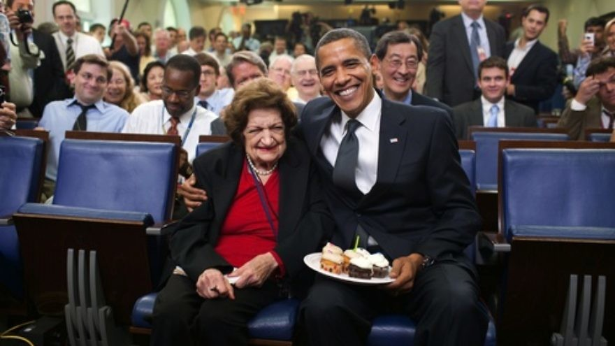 "Click photo to download. Caption: President Barack Obama presents cupcakes with a candle to Hearst White House columnist Helen Thomas in honor of her birthday in the James Brady Briefing Room, on Aug. 4, 2009. In 2010, Obama would go on to call Thomas's retirement following her anti-Semitic comments on the White House lawn ""the right decision."" Credit: Pete Souza/White House."