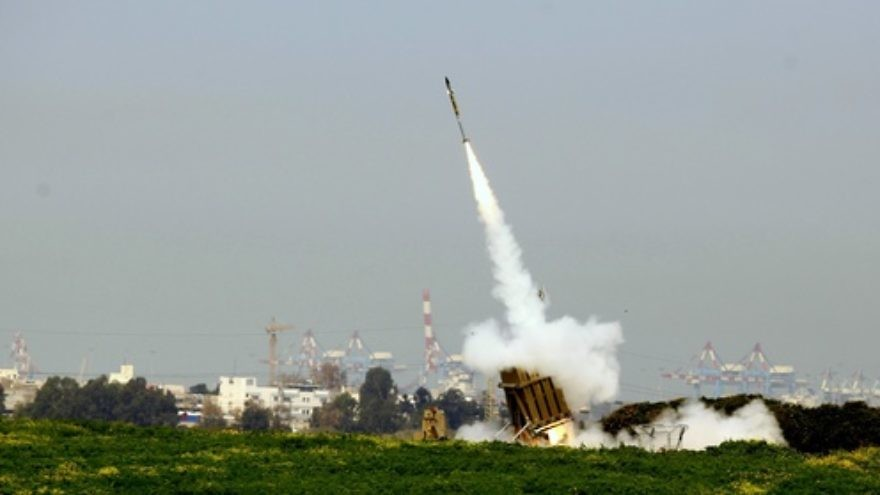 Click photo to download. Caption: On March 11, 2012, the Iron Dome system near the Israeli city of Ashdod works to intercept rockets fired from the Gaza Strip. Credit: Flash90.