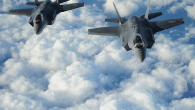 "Two Israeli F-35 ""Adir"" jets fly in formation after receiving fuel from a Tennessee Air National Guard KC-135 on Dec. 6, 2016. Credit: U.S. Air Force/1st Lt. Erik D. Anthony."
