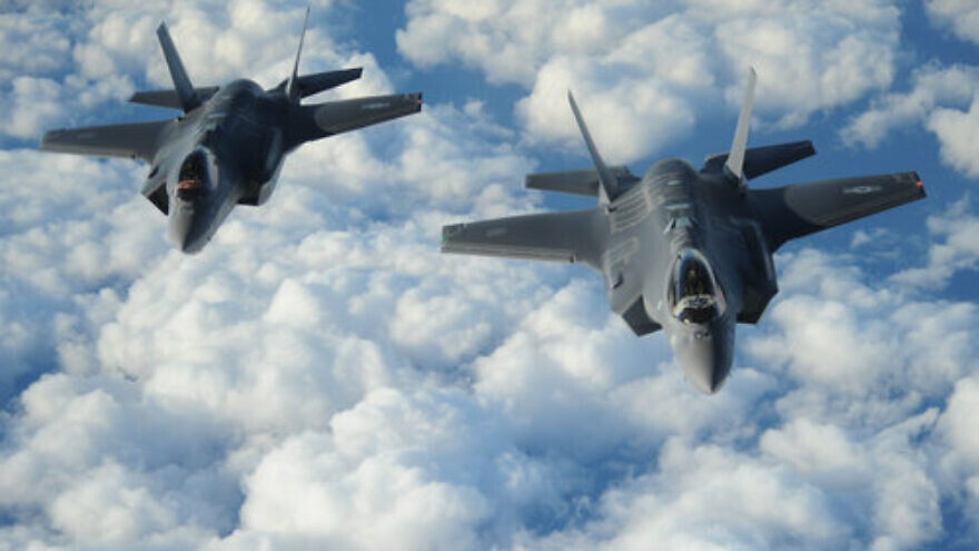 """Two Israeli F-35I """"Adir"""" jets fly in formation after receiving fuel from a Tennessee Air National Guard KC-135 on Dec. 6, 2016. Credit: U.S. Air Force/1st Lt. Erik D. Anthony."""