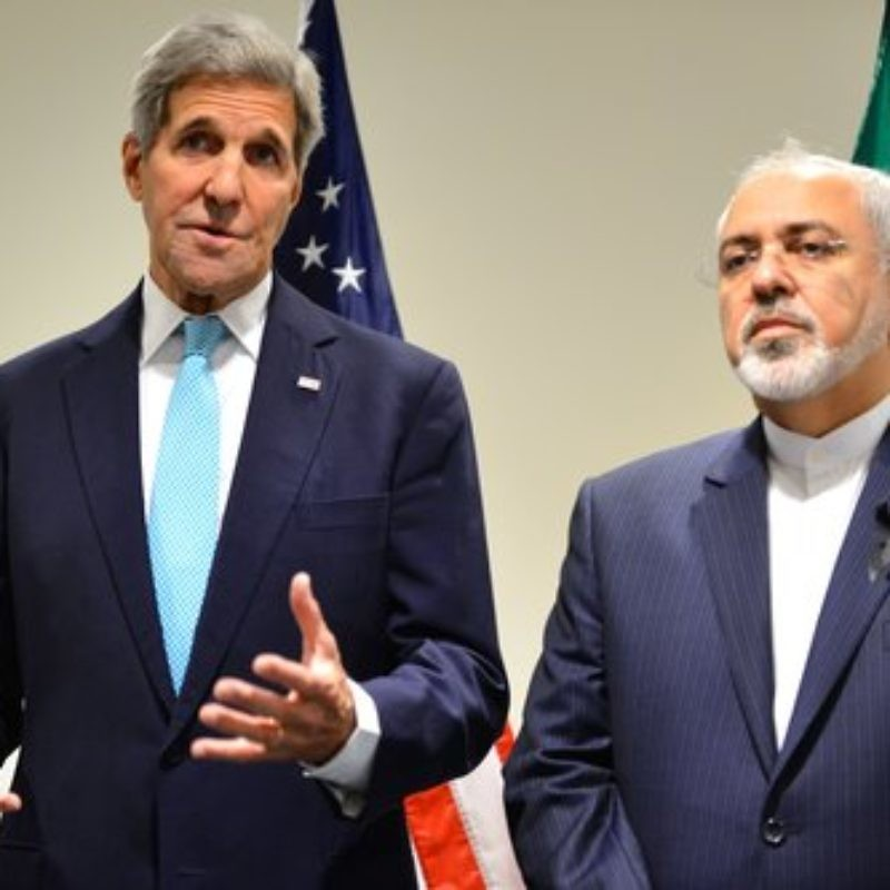 John Kerry (left), former U.S. Secretary of State for the Obama administration, with Iranian Foreign Minister Mohammad Javad Zarif in September 2015. Credit: State Department.