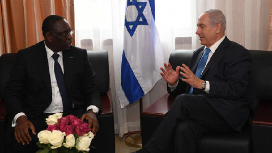 Israeli Prime Minister Benjamin Netanyahu (right) meets with Senegalese President Macky Sall on the sidelines of the Economic Community of West African States conference Sunday. Israel and Senegal agreed to restore full diplomatic ties. Credit: Kobi Gideon/GPO.