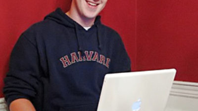Click photo to download. Caption: Facebook founder Mark Zuckerberg with his laptop. Credit: Wikimedia Commons.