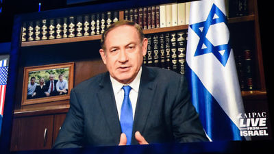"Prime Minister Benjamin Netanyahu, pictured here addressing the 2017 AIPAC policy conference via satellite, said the common dangers faced by Israel and its Arab neighbors present a ""rare opportunity"" to build a more peaceful future in the Middle East. Credit: AIPAC."