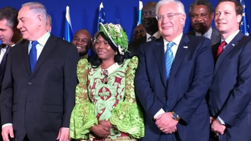 In front, Israeli Prime Minister Benjamin Netanyahu (left), U.S. Ambassador to Israel David Friedman (third from left) and Power Africa initiative Coordinator Andrew Herscowitz (right) attend the Dec. 4 signing of a memorandum of understanding on Israel's entrance into Power Africa. Credit: Alex Traiman.