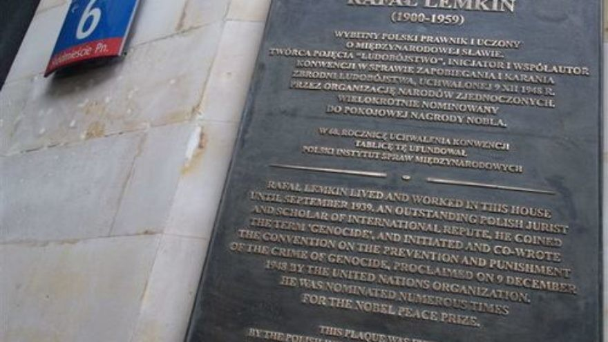 """A plaque on Kredytowa Street in Warsaw commemorating Raphael Lemkin, the Polish Jewish attorney and expert on the development of languages who coined the term """"genocide."""" Credit: Wuj Mat via Wikimedia Commons."""