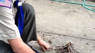 "Click photo to download. Caption: Boy Scout Abraham ""Avi"" Brudoley makes a bonfire. Pictured is step one: lay the groundwork. Credit: Maayan Jaffe."