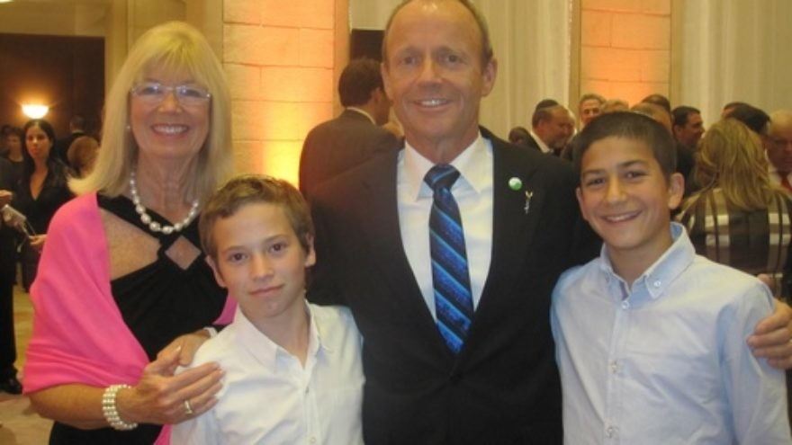 Click photo to download. Caption: Former Canadian cabinet minister Stockwell Day and his wife Valorie pictured with Israeli boys who each lost their fathers in a terrorist attack, at a state dinner during Canadian Prime Minister Stephen Harper's recent trip to Israel. Credit: Provided photo.