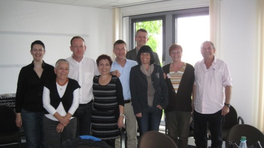 Pictured in Leipzig, Germany, are members of the Israeli team that partnered with Germany to assess how each country portrays the other's history in school textbooks, for ages 12-18, and to make recommendations to improve future textbooks. Third from right, in back, is Dirk Sawdowski, chairman of the German-Israeli Textbook Commission, and second from left, in back, is Dr. Arie Kizel, the chairman coordinating the Israeli team. Credit: Courtesy Dr. Arie Kizel.