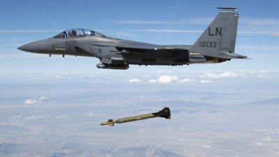 "A U.S. Air Force F-15E Strike Eagle aircraft releases a GBU-28 ""bunker buster"" 5,000-pound laser-guided bomb over the Utah Test and Training Range. Credit: TSGT Michael Ammons, USAF via Wikimedia Commons."