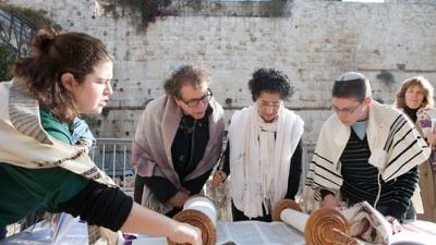 Click photo to download. Caption: Women of the Wall reading from the Torah at Robinson's Arch. Credit: Women of the Wall.