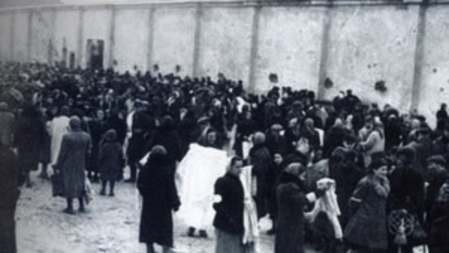 Click photo to download. Caption: Crowd near the wall of the Warsaw Ghetto. Credit: Photo courtesy of The David S. Wyman Institute for Holocaust Studies.