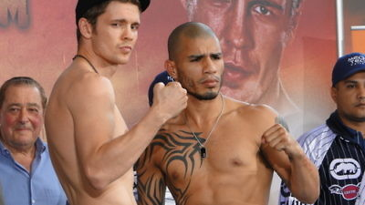 Click photo to download. Caption: Yuri Foreman (left) and Miguel Cotto at their official weigh-in on June 4, 2010. Foreman would lose the fight, and his world championship, the next day. Credit: Chamber of Fear via Wikimedia Commons.