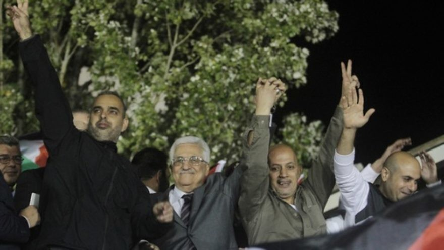 "Palestinian Authority leader Mahmoud Abbas (second from left) waves with released Palestinian prisoners coming from Israeli jails during celebrations at Abbas's headquarters in Ramallah, Oct. 30, 2013. Abbas at the celebration called freed terrorist prisoners ""heroes,"" Palestinian Media Watch reported at the time. Credit: Issam Rimawi/Flash90."