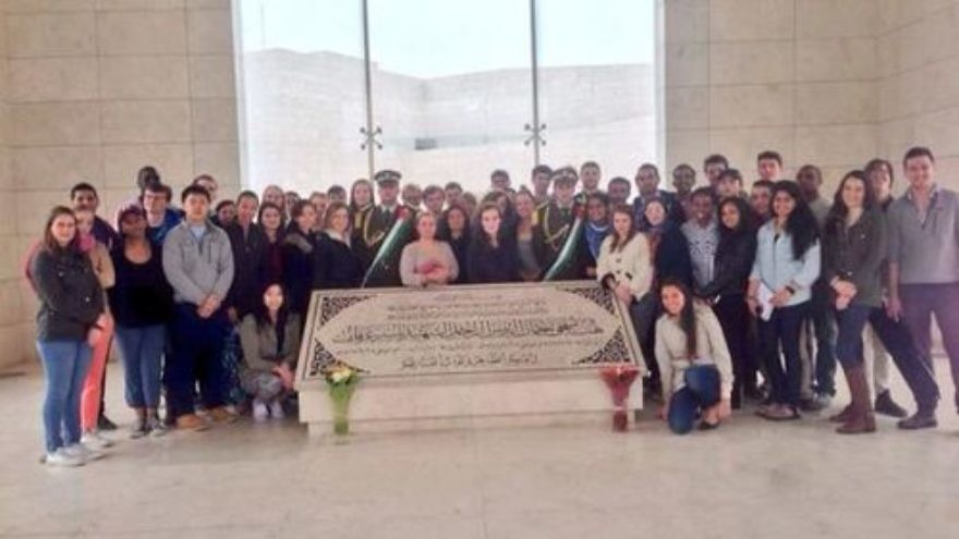 "Click photo to download. Caption: Harvard University students pose at Yasser Arafat's grave on a recent trip called ""Israel Trek"" that was sponsored by Harvard Hillel and Combined Jewish Philanthropies of Boston. Credit: Twitter."