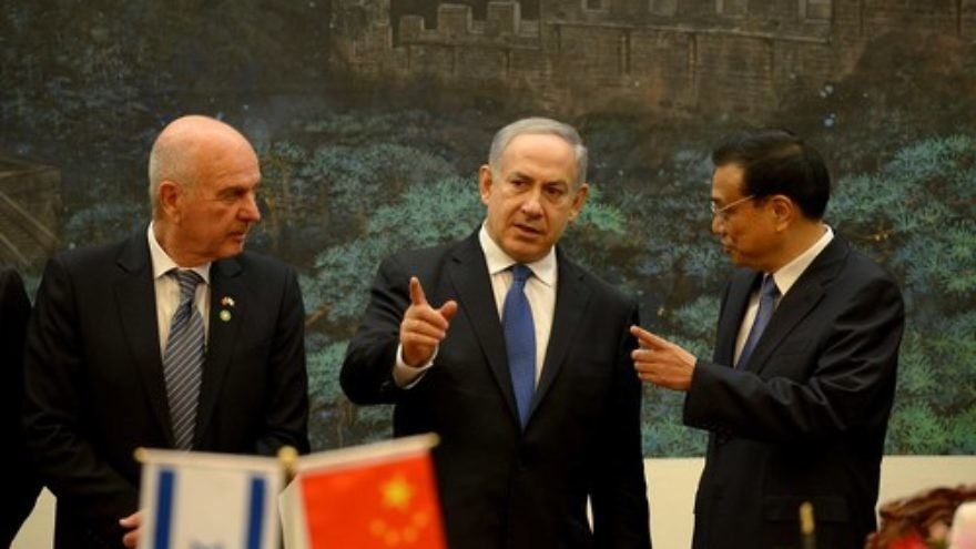 Click photo to download. Caption: Israeli Prime Minister Benjamin Netanyahu (center) talks to China's Premier Li Keqiang (right) during a signing ceremony at the Great Hall of the People in Beijing on May 8, 2013. Netanyahu is one of several Israeli leaders to make recent trips to China to nurture the Israeli-Chinese relationship, which just got another boost in the form of magnate Li Ka-Shing's $130 million to Israel's Technion University. Credit: Avi Ohayon/GPO/FLASH90.