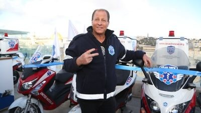 Click photo to download. Caption: Billionaire and philanthropist Stewart Rahr pictured with ambucycles at a Jan. 28 event in Jerusalem that marked his donation of 50 ambucycles, worth a total of $1.3 million, to United Hatzalah. Credit: United Hatzalah.