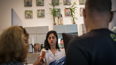 Pharmacists supply patients with prescribed medical cannabis at the Tikun Olam supplier's store in Tel Aviv, April 10, 2016. Credit: Hadas Parush/Flash90.