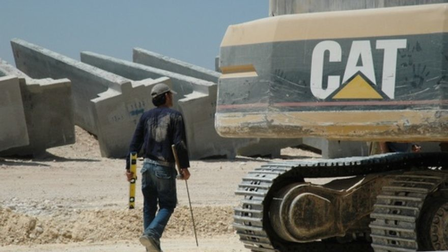 """Click photo to download. Caption: A Caterpillar bulldozer amid construction of the Israel's West Bank security fence. The Presbyterian Church (USA) General Assembly in July 2012 voted 333-331 against a resolution to divest from Caterpillar, Hewlett-Packard, and Motorola Solutions over those companies' profit """"from non-peaceful pursuits in Israel-Palestine."""" Now, the Presbyterian Church's new study guide on the Arab-Israeli conflict has been accused of being a """"hateful document"""" that """"promotes the eradication of Israel."""" Credit: Justin McIntosh via Wikimedia Commons."""