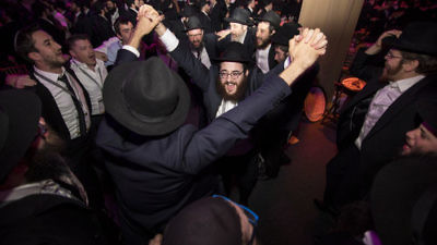 Emissaries and other guests rejoice during the Chabad-Lubavitch movement's 44th annual Kinus Hashluchim (gathering of emissaries) in  Bayonne, N.J., on Nov. 19. Credit: Chabad-Lubavitch
