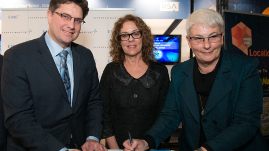 Click photo to download. Caption: Lockheed Martin and EMC executives sign an agreement to fund collaborative research at the new CyberSpark national cyber security complex in Be'er Sheva as Ben-Gurion University of the Negev President Prof. Rivka Carmi looks on. Credit: Provided photo.