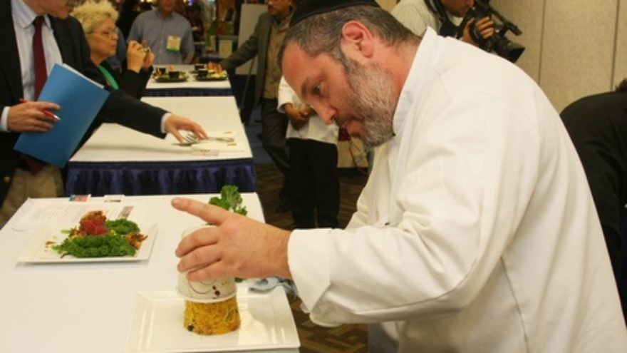 Click photo to download. Caption: An exhibitor at Kosherfest in Secaucus, NJ. Credit: Kosherfest