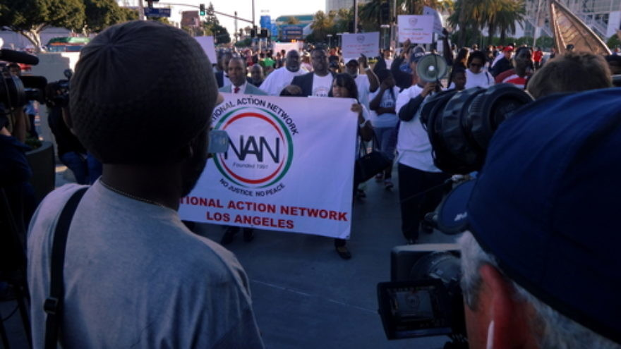 Click photo to download. Caption: National Action Network Los Angeles participants march alongside Staples Center in Los Angeles in reaction to the Donald Sterling scandal on April 29. Credit: Craig Dietrich via Wikimedia Commons
