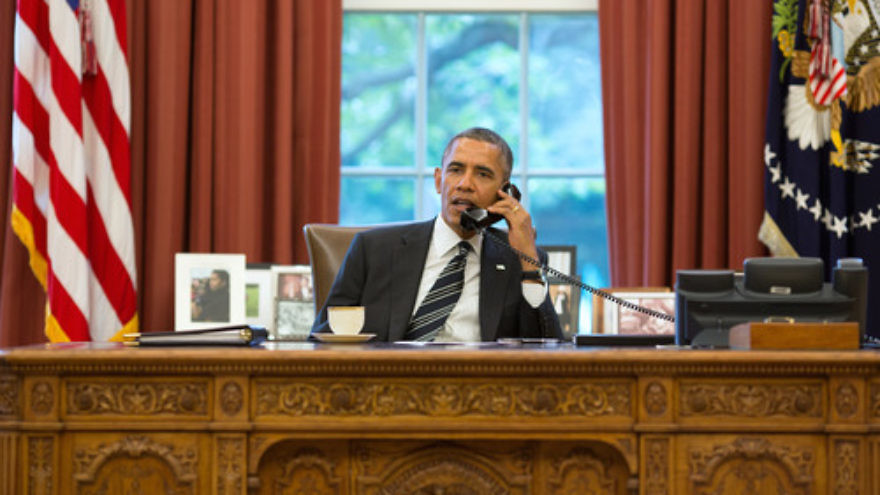 Click photo to download. Caption: U.S. President Barack Obama, sitting in the Oval Office, speaks on the phone with Iranian President Hassan Rouhani on Sept. 27, 2013. At the time, it was the first direct conversation between heads of the American and Iranian governments since 1979. Credit: Pete Souza/White House.
