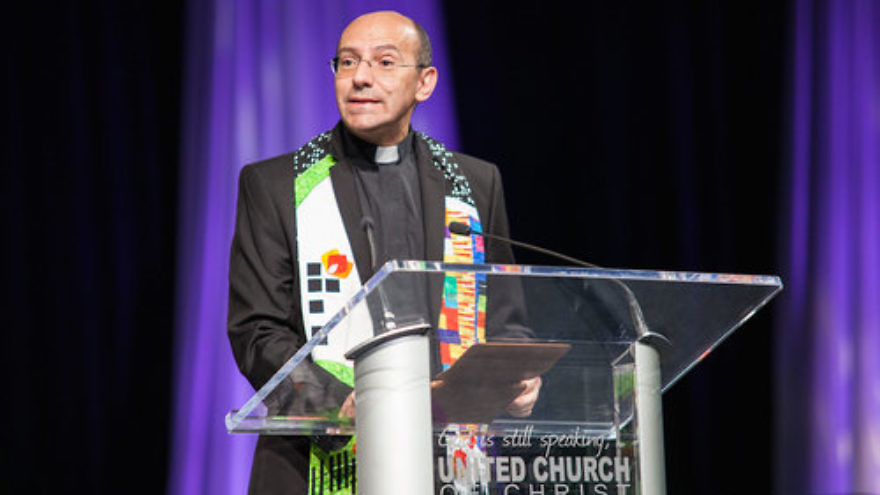 "Click photo to download. Caption: At the United Church of Christ (UCC) General Synod in Cleveland, Rev. Mitri Raheb (pictured here), a Palestinian Christian and pastor of the Evangelical Lutheran Church in Jordan and the Holy Land, called the UCC's resolution to divest from Israel ""a strong signal that [Palestinians] are not alone, and that there are churches who still dare to speak truth to power and stand with the oppressed."" Credit: United Church of Christ/Flickr."