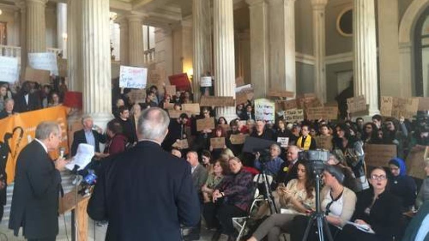 Click photo to download. Caption: Dr. Charles Jacobs (left, at podium) speaks out against Syrian refugee absorption on Monday at the Rhode Island State House. Credit: Courtesy Americans for Peace and Tolerance.