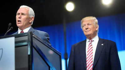 Rep. nominee Donald Trump watching his Vice Presidential running mate Mike Pence give a speech. Credit: Getty Images.