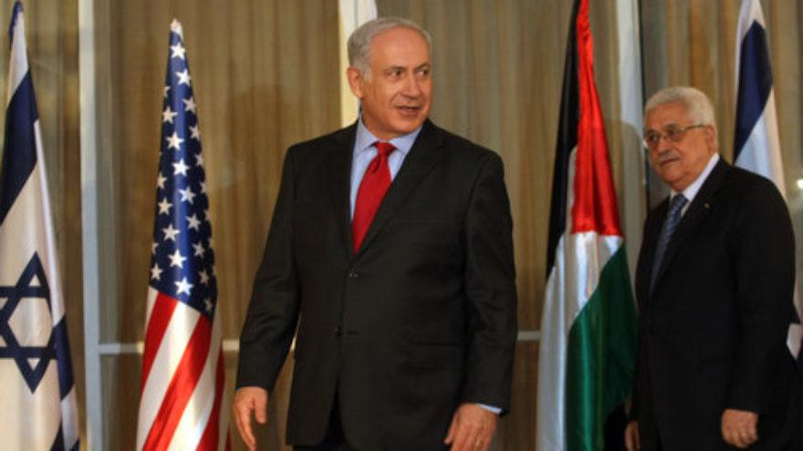 Israeli Prime Minister Benjamin Netanyahu stands with Palestinian Authority leader Mahmoud Abbas at his Jerusalem residence, September 2010. Credit: Kobi Gideon/Flash90.